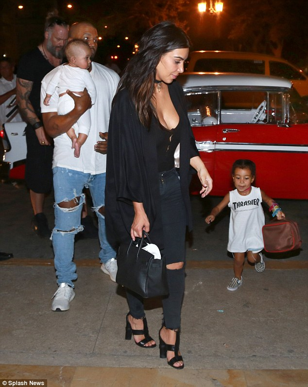 Photos: Papa Kanye West & Saint West 'Chill' As The Family Vacation In Cuba